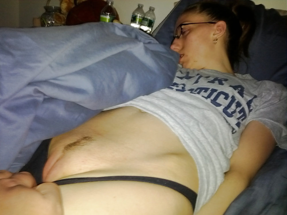 Black dude tugs his white lovers panties to the side so dog can lick her while she sleeps